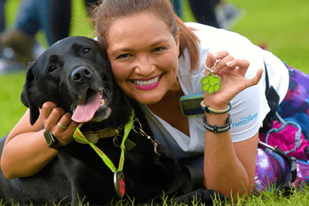 Dog and runner with medal